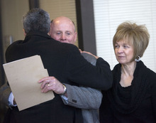 Al Hartmann      The Salt Lake Tribune   Carlos Escueda, assistant U.S. Attorney, left, consoles Richard and Tamara Davis, parents of Kiplyn Davis, as they leave 3rd Distict Courthouse in West Jordan after the verdict on Friday. Defendant Timmy Olsen pleaded guilty to second-degree felony manslaughter in the death of Kiplyn Davis.
