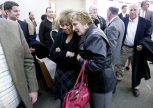 The Associated Press pool photo   Lenna Mendenhall (center right) hugs Tamara Davis, Kiplyn's mother, inside the courtroom after the hearing in 3rd District Court on Friday. Timmy Brent Olsen pleaded guilty to manslaughter in Kiplyn Davis's death.