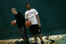 Photo courtesy Ramin Rahimian Eight-grader Kunal Sah, 13, plays basketball during physical education class at Green River High School March 7, 2007. Two months later Kunal represented Utah at the National Spelling Bee in Washington, D.C. A year earlier his parent,s Ken and Sarita Sah, had their asylum request denied and were deported  to India after more than a decade in the U.S. Kunal was born in the U.S. and therefore is a citizen. He stayed behind in Green River to get an education but joined his parents in India last year. The family hopes to return to the U.S. someday.