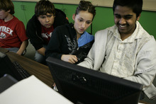 Photo courtesy Ramin Rahimian Kunal Sah, 13, left, plays an online computer game with classmates Armando Zamudio, left, and Bianca Trejo in computer keyboarding class at Green River High School March 7, 2007.