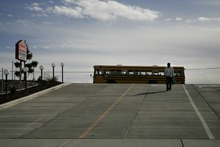 Photo courtesy Ramin Rahimian Kunal Sah, 13, walks down the driveway to his family's motel, the Ramada Limited, after being dropped off by a school bus in Green River March 7, 2007. His parents were deported a year earlier.