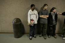 Photo courtesy Ramin Rahimian Kanal Sah, 13, left, waits in a hallway with classmates Cameron Ford, center, and Richard Wilson for the start of American history class during school at Green River High School March 7, 2007.