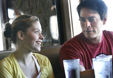 Scott Sommerdorf     The Salt Lake Tribune Ashley McAdam and her father Marty Cordova, a former Salt Lake Buzz player and the 1995 American League Rookie of the Year, have lunch Sunday in South Jordan. Ashley's T-shirt says,