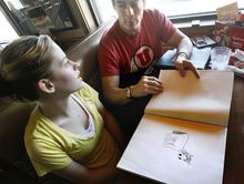 Scott Sommerdorf     The Salt Lake Tribune Ashley Morgan McAdam and her father, Marty Cordova, look at one of Ashley's drawings while at lunch Sunday in South Jordan.
