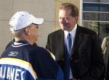 St. Louis Blues owner Dave Checketts greets a fan during a pep rally prior to the home opener on October 12, 2006 at Scottrade Center in St. Louis, Missouri. (Photo by Mark Buckner/St. Louis Blues)