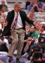 This May 22, 1997, file photo shows Utah Jazz head coach Jerry Sloan reacting after receiving a technical foul in the third period of an NBA game against the Houston Rockets, in Salt Lake City. Sloan, the longest-tenured coach in the NBA, stepped down Thursday after more than two decades on the job.  (AP Photo/Steve C. Wilson, File)