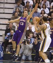Jeremy Harmon  |  The Salt Lake Tribune  Phoenix Suns guard Steve Nash (13) defends Utah Jazz guard Deron Williams (8) as the Jazz face the Phoenix Suns on Friday, February 11, 2011.