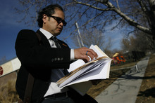 Francisco Kjolseth  |  The Salt Lake Tribune Raul Lopez-Vargas prepares to deliver a letter with 135 signatures to the Mexican Consulate in Salt Lake City on Monday asking the Mexican government to suspend visas to Mormon missionaries until the LDS Church takes a stronger stand on immigration reform.