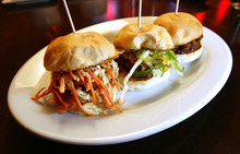 Scott Sommerdorf  l  The Salt Lake Tribune Jupiter Bowl caters best to bowlers. Opt to eat while bowling and order mainly from the list of appetizers and burgers. Pictured here, the slider combo; (from left to right), chicken, cheeseburger,and pork.