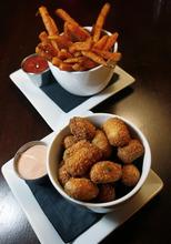 Scott Sommerdorf  l  The Salt Lake Tribune The sweet potato fries (top) and tater totsat the Jupiter Bowl in Park City.