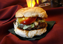 Scott Sommerdorf  l  The Salt Lake Tribune Jupiter Bowl in Park City caters best to bowlers. Opt to eat while bowling and order mainly from the list of appetizers and burgers.  Pictured here, the All-American Burger.