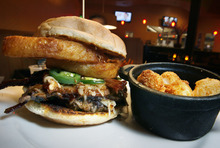 Scott Sommerdorf  l  The Salt Lake Tribune Jupiter Bowl in Park City caters best to bowlers. Opt to eat while bowling and order mainly from the list of appetizers and burgers. Pictured here, the smokehouse burger.