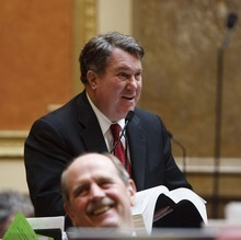 Trent Nelson  |  The Salt Lake Tribune Rep. LaVar Christensen addresses HB199, which would allow advertisements on school buses, at the state capitol in Salt Lake City, Utah, Tuesday, February 15, 2011. In the foreground is Rep. Richard Greenwood.