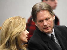 Keith Brown, right, talks to his sister-in-law before a hearing in Provo 4th District Court in Provo on Thursday, Feb. 17, 2011. Brown, the father of the musical group