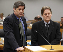 Keith Brown, right, and his attorney Steven Shapiro talk to the judge at his hearing in Provo 4th District Court in Provo on Thursday, Feb. 17, 2011. Brown, the father of the musical group
