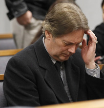 Keith Brown sits and waits for his hearing in Provo 4th District Court in Provo, Utah, Thursday, Feb. 17, 2011. Brown, the father of the musical group