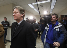Keith Brown, left, leaves court after pleading guilty at his hearing in Provo 4th District Court in Provo, Utah, Thursday, Feb. 17, 2011. Brown, the father of the musical group