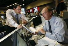 Scott Sommerdorf  l  Tribune file photo Matt Gephardt, left, confers with his father, Bill Gephardt, of