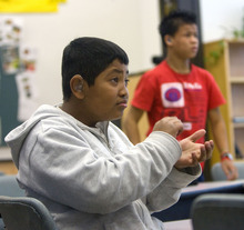 Al Hartmann   |  The Salt Lake Tribune  Argenis Valentin, a ninth-grader at Jean Massieu School of the Deaf, answers a question in his earth science class using American Sign Language. He is one of 100 students at the Millcreek school.