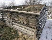 Steve Griffin  |  The Salt Lake Tribune   The Drown Log Cabin in Midvale on Thursday, Feb. 17, 2011.  The cabin was erected in 1866 and is the last standing pioneer farm home in the Midvale area. Chelsea Rushton is the director of the Midvale Museum and with the help of others is restoring the cabin.