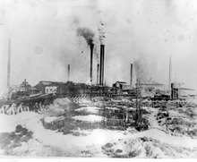 The pioneer cemetary in the early 1900s. The United States Mining and Smelting Company's copper smelter is in the background. Courtesy Midvale Museum