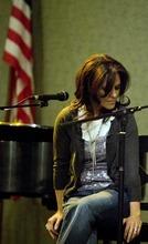 Djamila Grossman  |  The Salt Lake Tribune Rachelle Call, an LDS songwriter, listens to a singer during