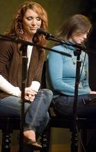 Djamila Grossman  |  The Salt Lake Tribune Jessie Clark Funk and Nicole Riding listen to a singer during