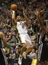 Rick Egan   |  The Salt Lake Tribune  Utah Jazz guard Deron Williams (8) takes the game in to his own hands as he drives up the middle for a shot, in NBA action in Salt Lake City, Wednesday, Jan. 26, 2011. Williams is being traded to the New Jersey Nets.