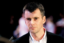 Russian billionaire Mikhail Prokhorov speaks to the media before a basketball show in Moscow, Russia, Sunday, Oct. 10, 2010. Mikhail Prokhorov bought basketball team New Jersey Nets earlier in the year. (AP Photo/Ivan Sekretarev)
