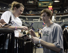 Utah Jazz forward and former Butler standout Gordon Hayward signs autographs for fans before the start of an NBA basketball game against the Indiana Pacers in Indianapolis, Friday, Feb. 25, 2011. (AP Photo/Tom Strattman)