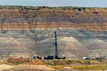 An oil rig drills in 2005 amid high desert red cliffs about 30 miles south of Vernal. Tribune file photo