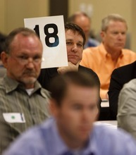 In this 2009 Tribune file photo, Brad Wixon of International Petroleum bids on a parcel during an oil- and gas-lease auction at the Bureau of Land Management office in Salt Lake City.