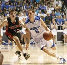 Paul Fraughton  |  The Salt Lake Tribune   Fremont's Nick Vigil drives past Alta's Jacob Knowles in the opening round of the boys' 5A Basketball Championships at Weber State's Dee Events Center on Monday February 28, 2011.