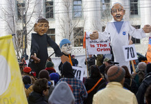 Al Hartmann   |  The Salt Lake Tribune  Puppets of a federal judge, left, Tim DeChristopher, center, and NASA climatologist James Hansen are used in a skit during a rally to support DeChristopher across the street from the federal couthouse where his trial is set to begin Monday.