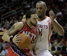 New Jersey Nets' Deron Williams, left, pushes against Houston Rockets' Chuck Hayes during the first half of an NBA basketball game Saturday, Feb. 26, 2011, in Houston. The Rockets won 123-108. (AP Photo/Pat Sullivan)