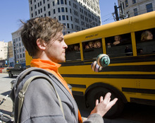 Al Hartmann   |  The Salt Lake Tribune  Adam Barkley of Salt Lake City, a Tim DeChristopher supporter, juggles Tuesday for a group of elementary students that had toured the Frank Moss Federal Courthouse.   Other supporters sang