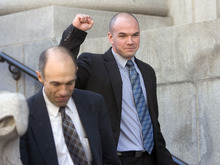 Al Hartmann   |  The Salt Lake Tribune  Tim DeChristopher pumps his fist to supporters as he leaves  Frank Moss Federal Court in Salt Lake City on Tuesday after his first day of trial on charges of disrupting an oil and gas lease auction.