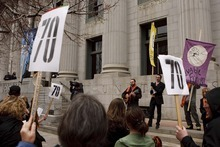 Trent Nelson  |  The Salt Lake Tribune Supporters of Tim DeChristopher sing songs and wave signs outside of the Frank Moss Federal Courthouse in Salt Lake City on Wednesday, March 2, 2011.