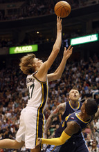 Photo by Chris Detrick | The Salt Lake Tribune  Utah Jazz small forward Andrei Kirilenko (47) shoots over Denver Nuggets shooting guard J.R. Smith (5) and Denver Nuggets center Chris Andersen (11) during the second half of the game at EnergySolutions Arena Thursday March 3, 2011.  Denver won the game 103-101.