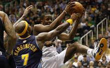 Photo by Chris Detrick | The Salt Lake Tribune  Utah Jazz small forward C.J. Miles (34) grabs a rebound past Denver Nuggets power forward Al Harrington (7) during the second half of the game at EnergySolutions Arena Thursday March 3, 2011.  Denver won the game 103-101.