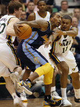 Photo by Chris Detrick | The Salt Lake Tribune  Utah Jazz small forward Gordon Hayward (20) and Utah Jazz point guard Earl Watson (11) guard Denver Nuggets shooting guard J.R. Smith (5) during the second half of the game at EnergySolutions Arena Thursday March 3, 2011.  Denver won the game 103-101.