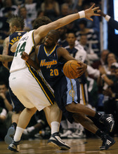 Photo by Chris Detrick | The Salt Lake Tribune  Utah Jazz center Kyrylo Fesenko (44) guards Denver Nuggets point guard Raymond Felton (20) during the second half of the game at EnergySolutions Arena Thursday March 3, 2011.  Denver won the game 103-101.