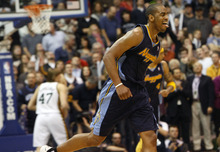 Photo by Chris Detrick | The Salt Lake Tribune  Denver Nuggets shooting guard Arron Afflalo (6) celebrates after hitting a three-pointer during the second half of the game at EnergySolutions Arena Thursday March 3, 2011.  Denver won the game 103-101.
