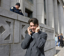 Al Hartmann   |  The Salt Lake Tribune  Ryan Pleune, a supporter of Tim DeChristopher, talks on phone and waits outside the Frank Moss Federal Courthouse on Thursday afternoon waiting for a verdict from the jury. He was fired from the Salt Lake School District for taking a detour with his school bus earlier in the week to show students the peaceful protesters at the courthouse.