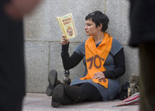 Al Hartmann   |  The Salt Lake Tribune  Brittany Florio, a supporter of Tim DeChristopher, sits and reads against the Frank Moss Federal Courthouse on Thursday afternoon waiting for the jury to come back with a verdict. DeChristopher is on trial on charges of interfering with an oil and gas lease auction.