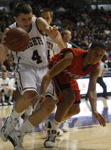 Photo by Chris Detrick   The Salt Lake Tribune  Lone Peak's Nick Emery (4) is guarded by American Fork's Marcel Davis (22) during the first half of the game at the Dee Events Center Saturday March 5, 2011.