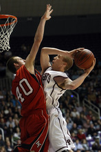 Photo by Chris Detrick   The Salt Lake Tribune  Lone Peak's Jordan Hamilton (41) shoots over American Fork's Nate Ensign (40) during the second half of the game at the Dee Events Center Saturday March 5, 2011.  Lone Peak won the game 64-52.