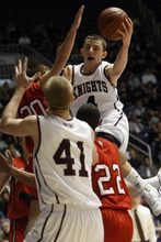 Photo by Chris Detrick   The Salt Lake Tribune  Lone Peak's Nick Emery (4) passes around American Fork's Danny Beddes (20) during the second half of the game at the Dee Events Center Saturday March 5, 2011.  Lone Peak won the game 64-52.