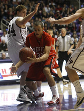Photo by Chris Detrick   The Salt Lake Tribune  American Fork's Quincy Bair (32) is guarded by Lone Peak's Colton Shumway (44) during the first half of the game at the Dee Events Center Saturday March 5, 2011.