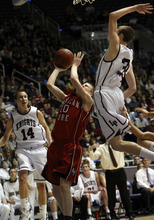 Photo by Chris Detrick   The Salt Lake Tribune  Lone Peak's Mason Smith (33) blocks American Fork's Michael Wells (10) during the first half of the game at the Dee Events Center Saturday March 5, 2011.